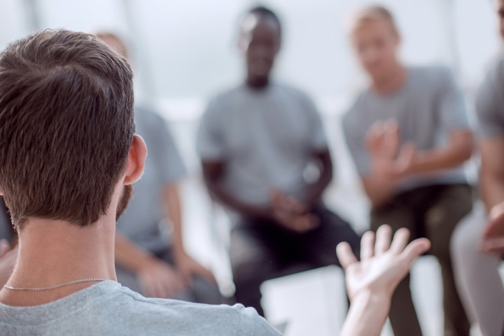 close up. young people are discussing something sitting in a circle.